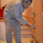 Professor Anil Kumar Lighting the Diya