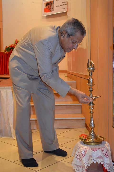Professor Anil Kumar Lighting the Diya